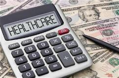 calculator-on-money-with-healthcare-written-on-it