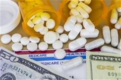 Pills spilled onto medicare card and money