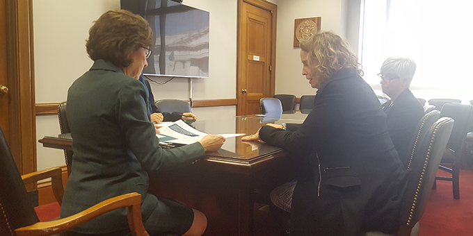 Regan Gallagher, DO (right) discusses the Cancer Care Planning and Communications Act  with Senator Susan Collins (Maine)
