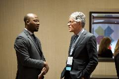 Olalekan Ajayi, PharmD, MBA, Welch Cancer Center, Sheridan Memorial Hospital, and Randall Oyer, MD, Lancaster General Hospital, exchange ideas between sessions.