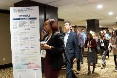 Attendees navigate to their tracks of choice during the meeting breakout sessions.