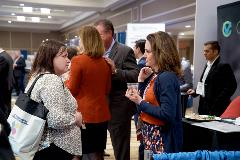 Attendees network with other oncology professionals in the Exhibit Hall.