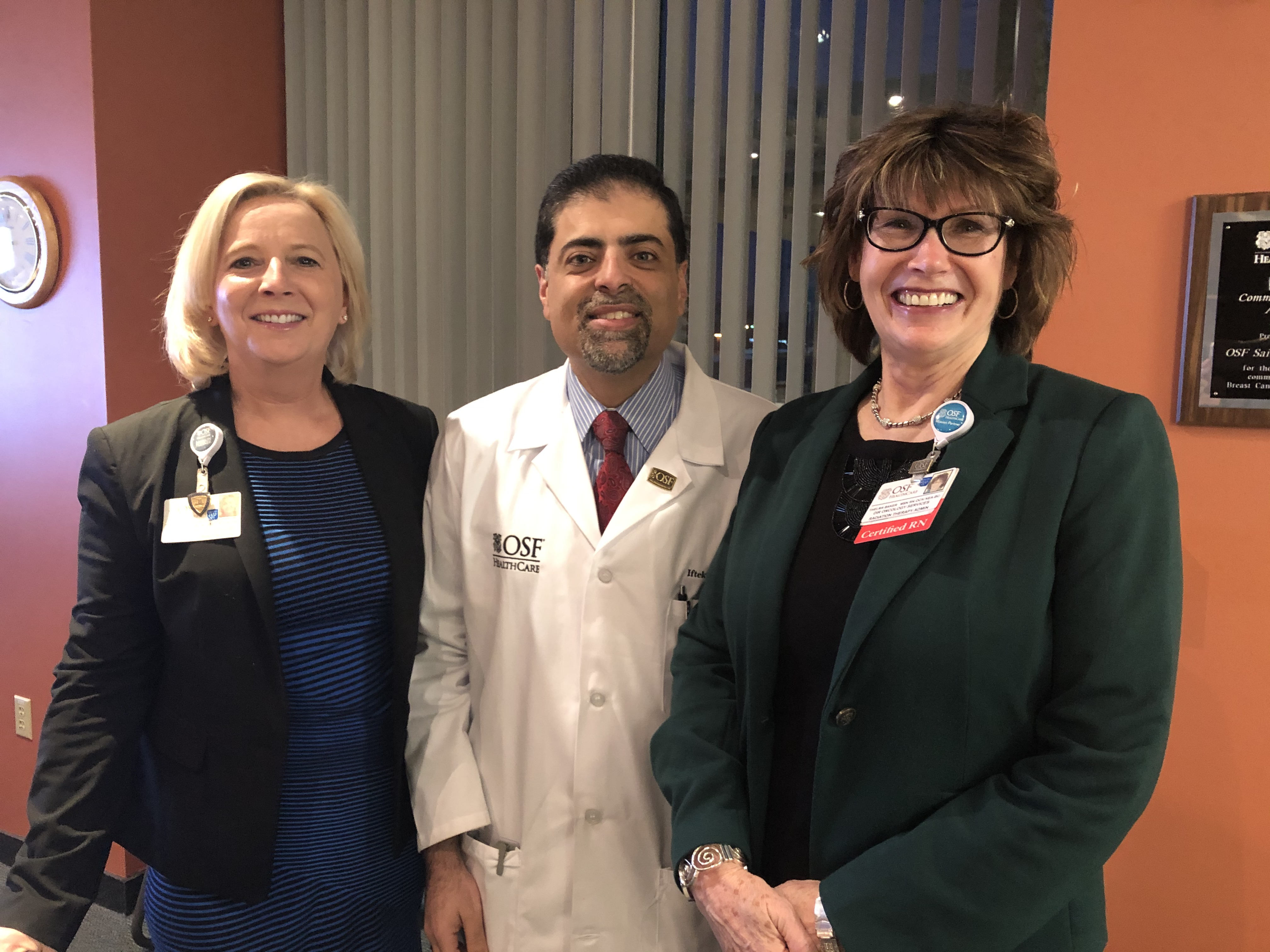 Paula Caryski, President,  OSF Health, Dr. Iftekhar Ahmad, Radiation Oncologist, and Thelma Baker, Director of Oncology